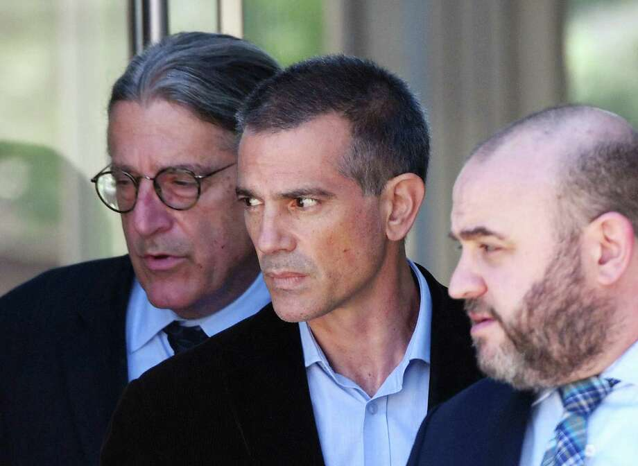 Fotis Dulos, center, is accompanied by his attorneys Norm Pattis, left, and Rich Rochlin after making an appearance at state Superior Court in Stamford,on June 26. Photo: Tyler Sizemore / Hearst Connecticut Media / Greenwich Time