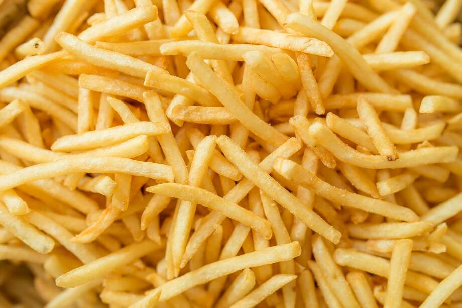 """FILE — A teen told doctors that since elementary school, """"he had a daily portion of fries from the local fish and chip shop and snacked on Pringles (Kellogg), white bread, processed ham slices, and sausage."""" Photo: Getty Images / antpkr"""