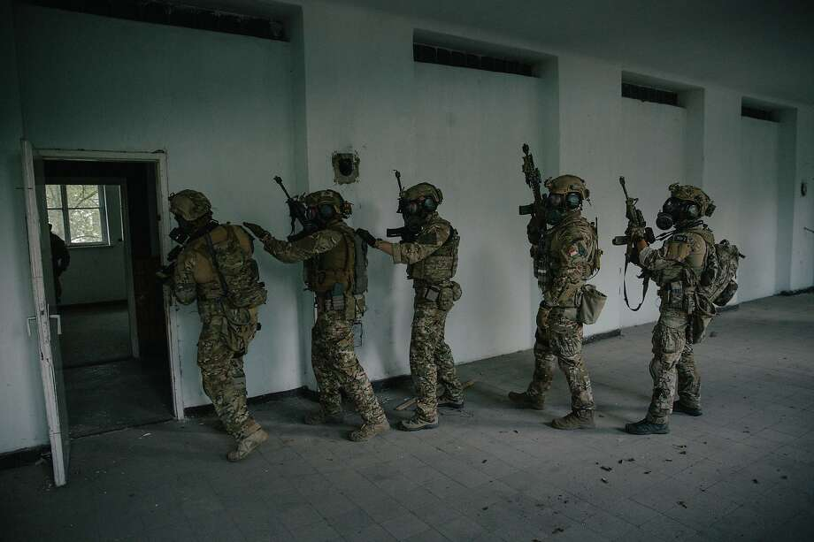 Hungarian commandos conduct a mock raid during exercises with U.S. Special Operation Forces. Photo: Nanna Heitmann / New York Times