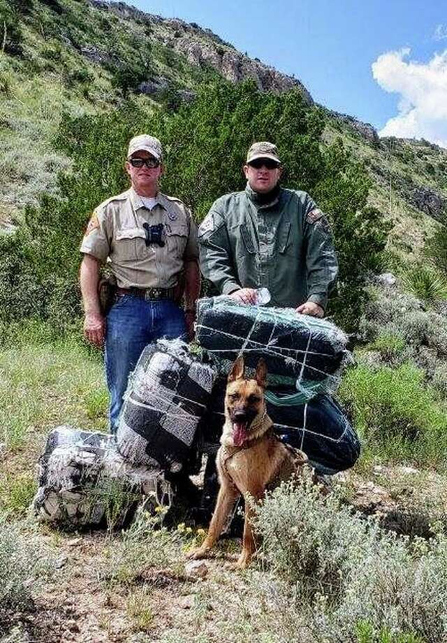 Brewster County Deputies along with K9 Latek, tracked and apprehended four illegal immigrants, smuggling approximately 300 pounds of marijuana. Photo: Brewster County Sheriff's Office, Facebook