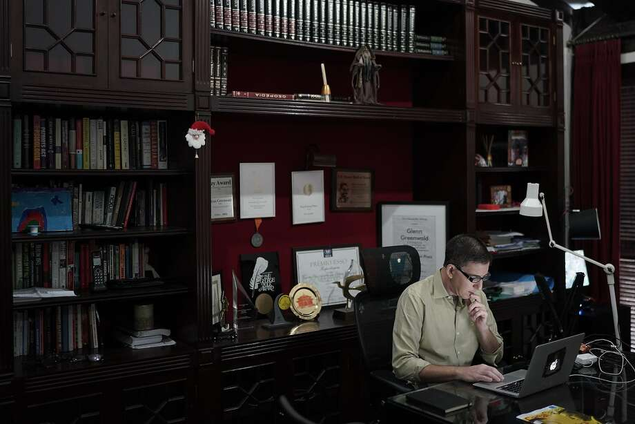 In this July 10, 2019 photo, U.S. journalist Glenn Greenwald checks his news website, at his home in Rio de Janeiro, Brazil. Being the center of controversy is nothing new for Greenwald, who was part of a team at The Guardian newspaper that won a Pulitzer for reports about government surveillance programs based on classified documents disclosed by Edward Snowden. (AP Photo/Leo Correa) Photo: Leo Correa / Associated Press