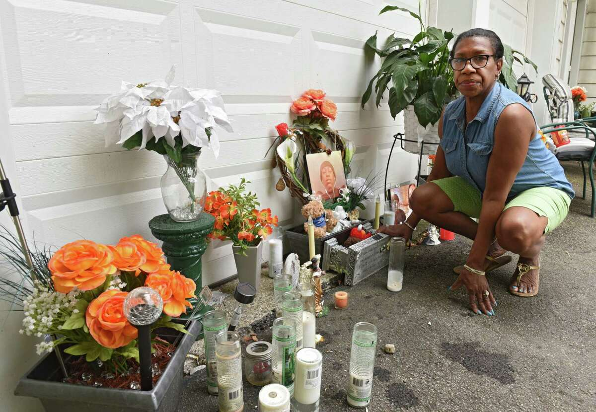 Mary Gause is seen next to the new memorial in her driveway to commemorate her son Dalon Blunt on Friday, July 12, 2019 in Albany, N.Y. Police took down a memorial that was built in her driveway to commemorate her son Dalon, a 28-year-old man who was shot and killed in Albany in December. (Lori Van Buren/Times Union)
