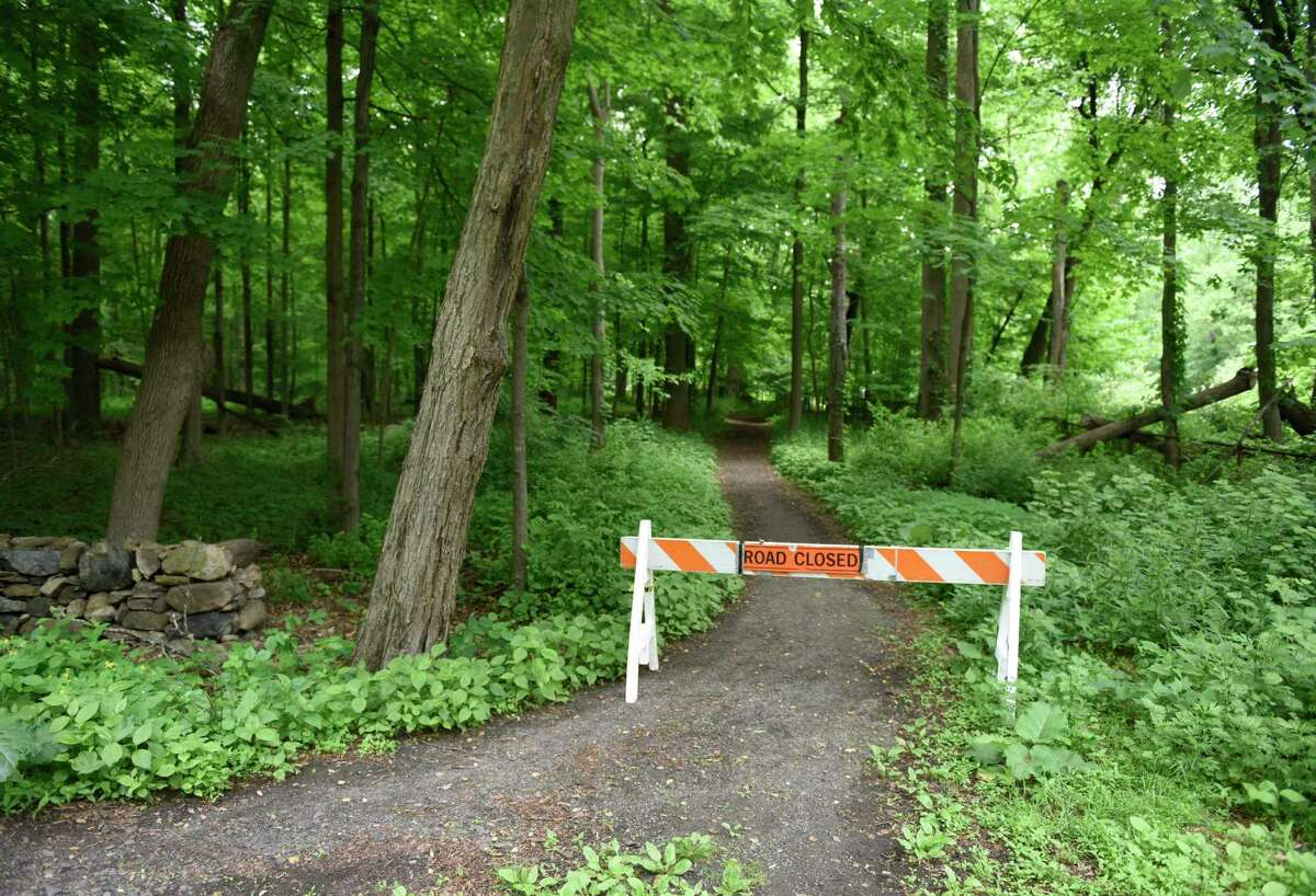 Police block off trails as they search for missing person Jennifer Dulos on the southern end of Waveny Park in New Canaan, Conn. Wednesday, May 29, 2019. Dulos was reported missing Friday evening and police searched the area surrounding her neighborhood on Tuesday and the woods of Waveny Park on Wednesday.