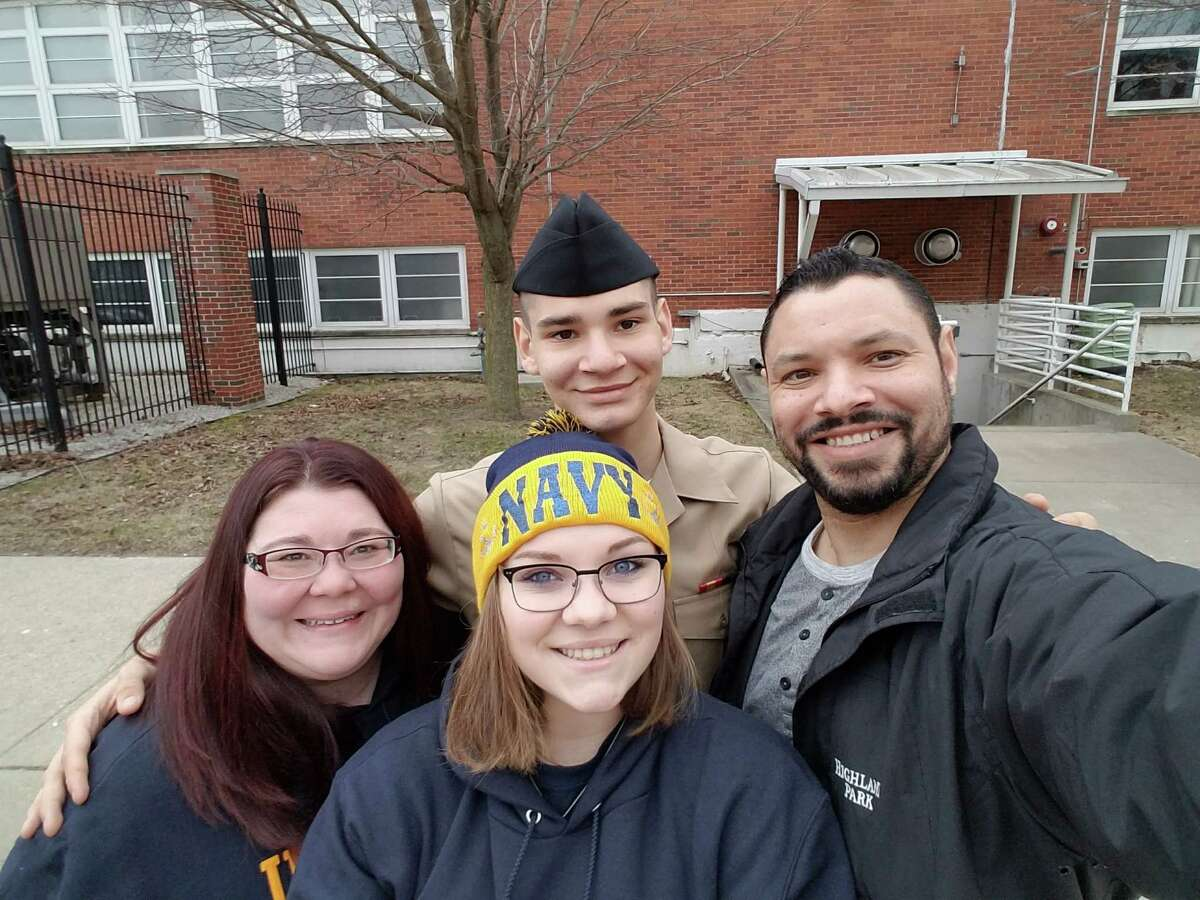 From left, Jolee Hicks, Sienna Hicks, Macoy Hicks and Michael Hicks pose for a photo in Chicago after Macoy Hicks graduated from Navy boot camp.