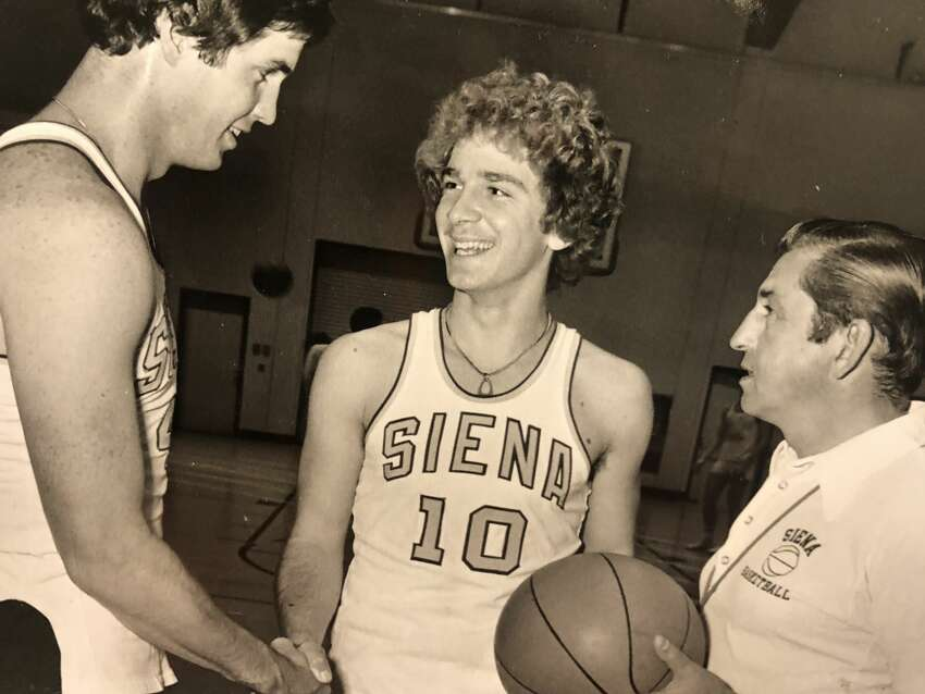 Siena point guard Mike Catino, center, was a member of the first Saints Division-I team in 1976-77, and twice led the Saints in scoring.
