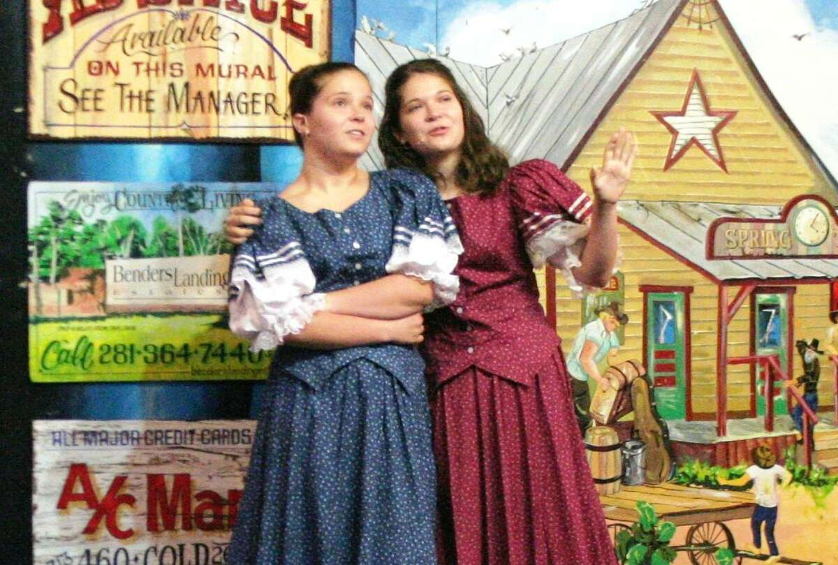 Actors perform on stage at Puffabelly's in Old Town Spring during Old West Melodrama's production of