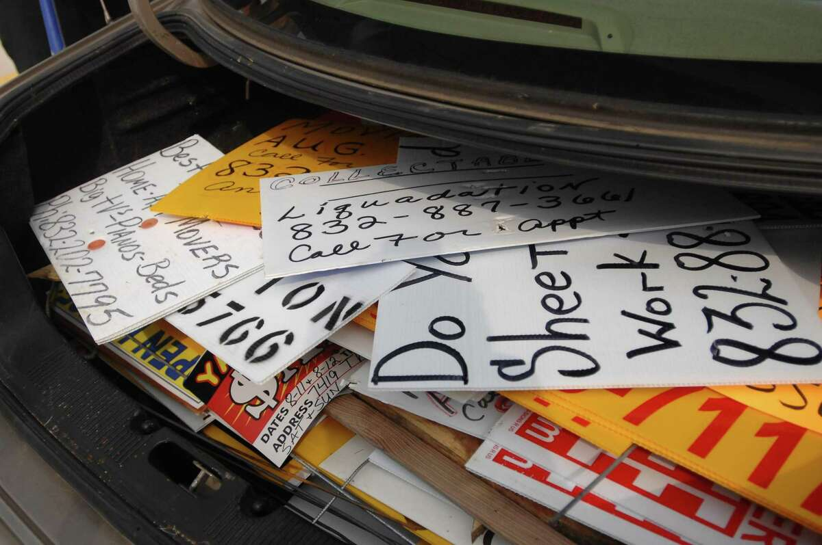 A trunk full of illegal bandit signs were collected along FM 1960 on 9/1/07. Photo by Thomas Nguyen/For the Chronicle.