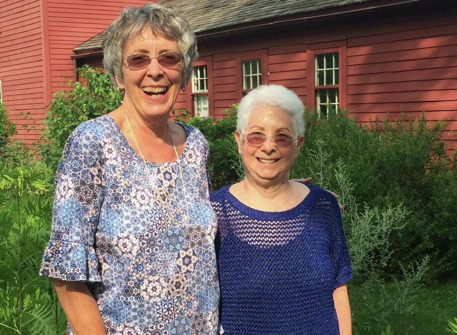 Bobbi Kahan, left, and Jackie Algon, stand in the heirloom garden at the Wilton Historical Society, which named them volunteers of the year for their work with the flowers and herbs. Photo: Allison Sanders / Wilton Historical Society / Wilton Bulletin Contributed
