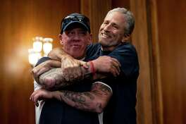 Former Daily Show host Jon Stewart, right, hugs John Feal, founder of the FealGood Foundation, an advocacy group for first responders, during a news conference before the vote on a bill which would authorize $10.2 billion for the September 11th Victim Compensation Fund, on Capitol Hill in Washington on Friday, July 12, 2019. (Anna Moneymaker/The New York Times)