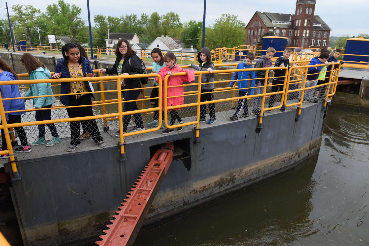 Fourth-graders from the Shenendehowa School District take a tour of Lock E-2 on the Erie Canal during the opening day of the New York Sate Canal System's navigational season on Friday morning, May 17, 2019, in Waterford, N.Y. About half of the canal is closed due to high water levels. It is open locally from locks E-2 to E-8 in Scotia. Opening of the Champlain Canal is also delayed.