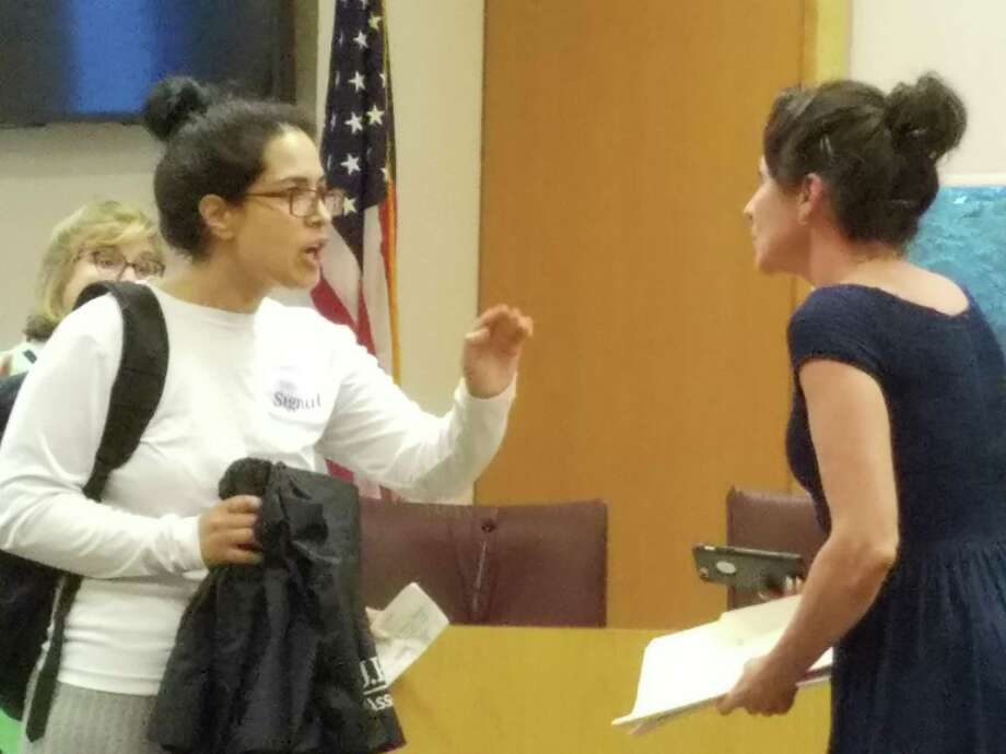 Jarva Jafri claimed her parking ticket was because of racism at the New Canaan Parking Commission on Thursday, July 11, 2019, Parking Manager Stacy Miltenberg, to the right, asked her to leave. Photo: Grace Duffield