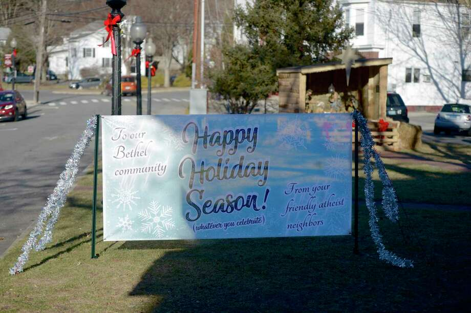 "The Bethel Board of Selectman are expected to discuss next week a policy for what holiday displays are allowed on town property. This holiday banner from ""your friendly atheist neighbors"" created controversy last year. Bethel Conn, December 18, 2018. Photo: H John Voorhees III / Hearst Connecticut Media / The News-Times"