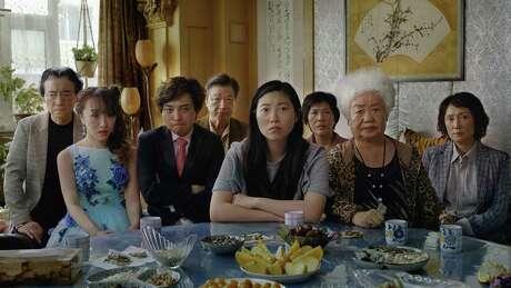 """Jian Yongbo, Kmamura Aio, Chen Han, Tzi Ma, Awkwafina, Li Ziang, Tzi Ma, Lu Hong and Zhao Shuzhen appear in a still from """"The Farewell."""" (Sundance Institute/Big Beach/TNS)"""