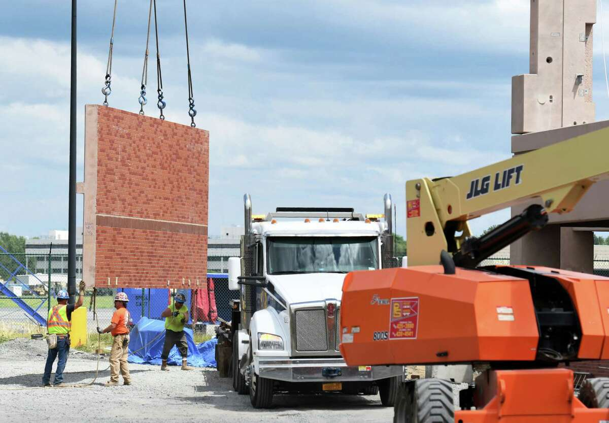 A cement wall is moved with a crane during construction on the new Albany International Airport parking garage on Friday, July 12, 2019 at Albany International Airport in Colonie, NY. (Phoebe Sheehan/Times Union)
