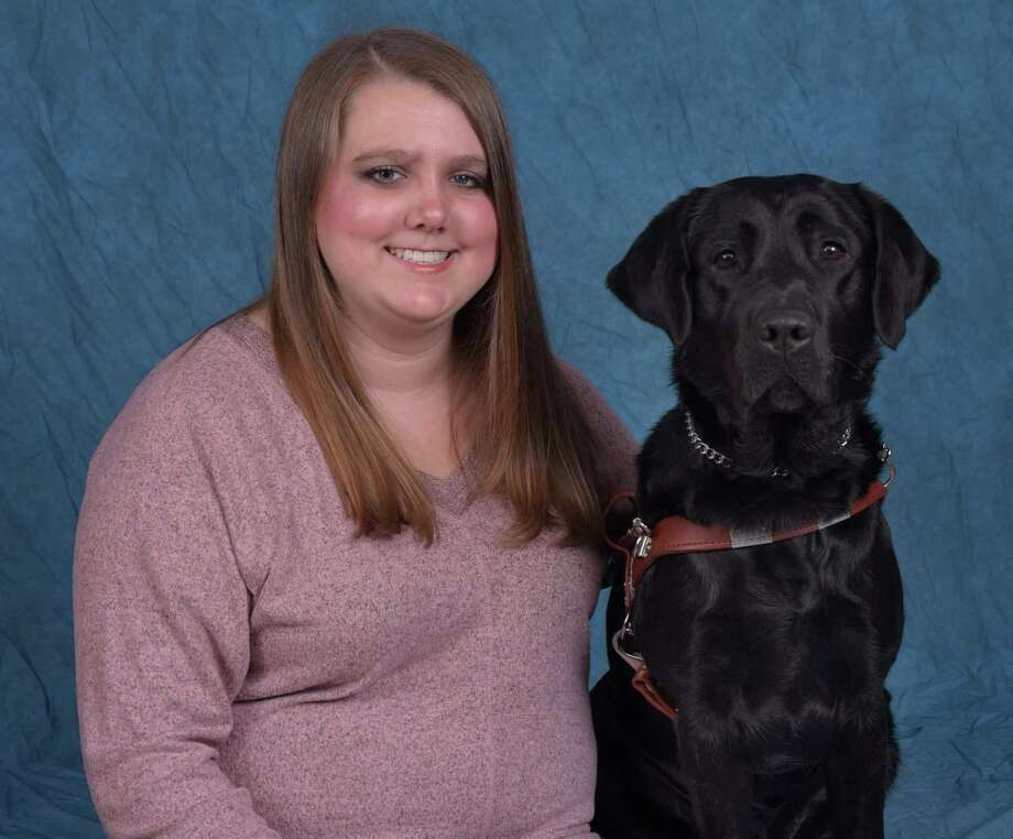 Cypress native Ashley Pryor sits with her new guide dog from Guiding Eyes for the Blind, Yaz. Photo: Guiding Eyes For The Blind