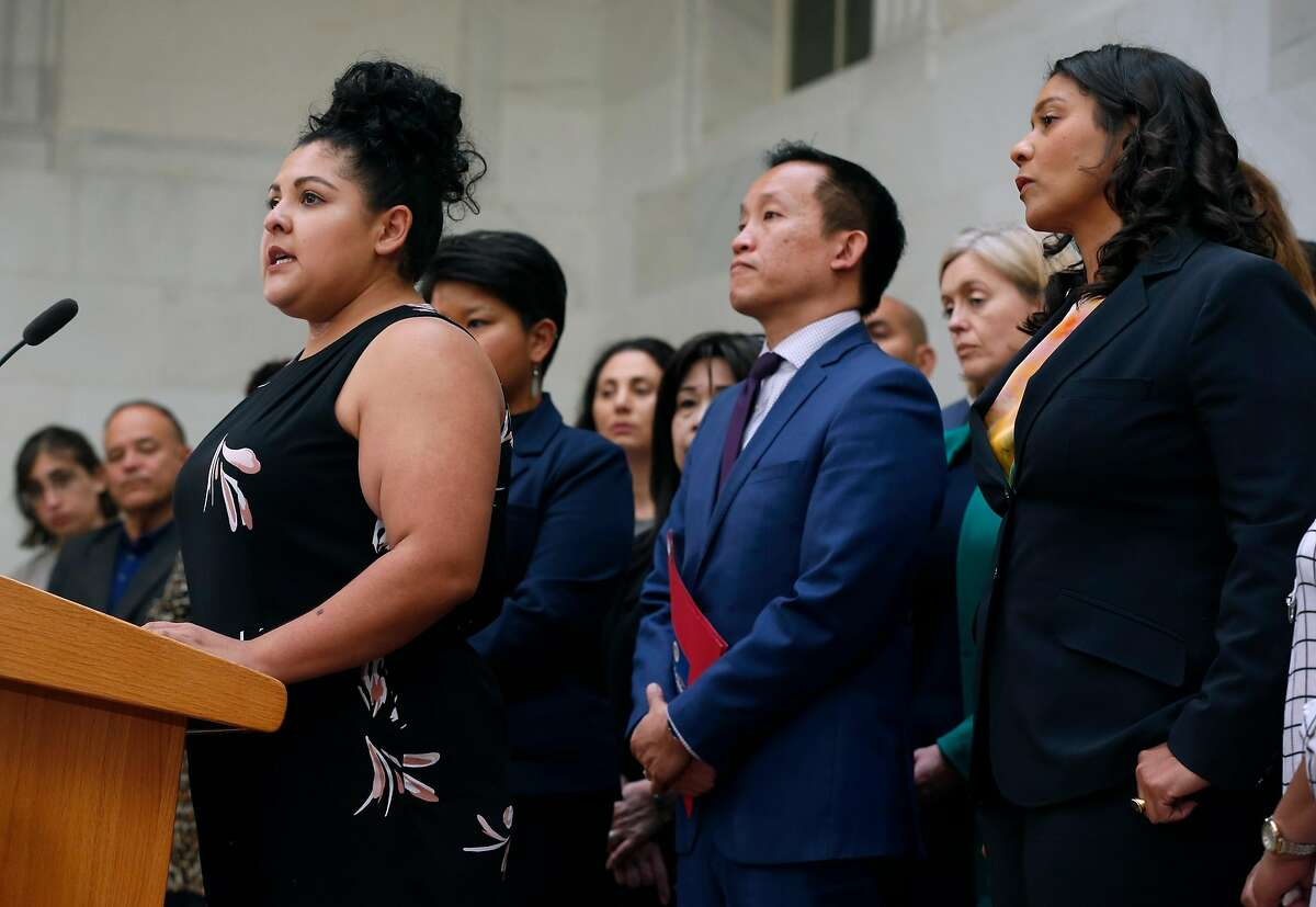 Marisela Esparza, from Dolores Street Community Services, speaks at a City Hall news conference called by Mayor London Breed in San Francisco, Calif. on Friday, July 12, 2019 to remind immigrants of their rights, ahead of planned raids by ICE agents beginning this weekend.