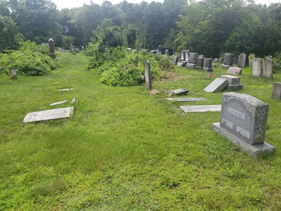 Headstones knocked over at the cemetery. Photo: Contributed Photo