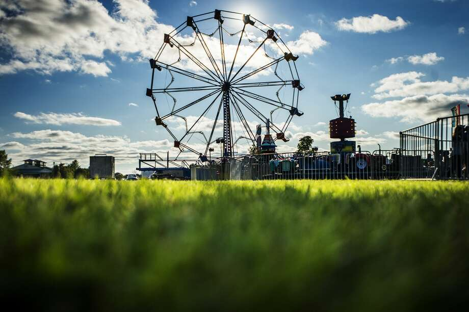 Sunlight shines through the ferris wheel at the Auburn Cornfest on Thursday, July 11, 2019 in Auburn. (Katy Kildee/kkildee@mdn.net) Photo: (Katy Kildee/kkildee@mdn.net)