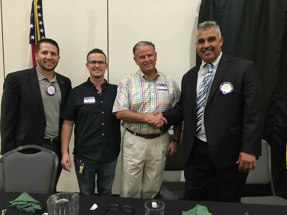 Last week members of the Conroe Noon Lions Club listened intently to the courageous stories by Jeff Turner and Jeff Turner, Jr. of their violent armed robberies and the tips they have to be prepared. Pictured: (l-r) Lion Patrick Hebert, Jeff Turner, Jr., Jeff Turner, Vice President Rafael Perez. Photo: Courtesy Photo