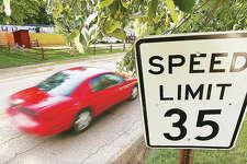 A car drives down Stanley Road in Cottage Hills past a residential area Friday. A reduced speed limit of 25 mph will take effect in residential areas of unincorporated Wood River Township next week.