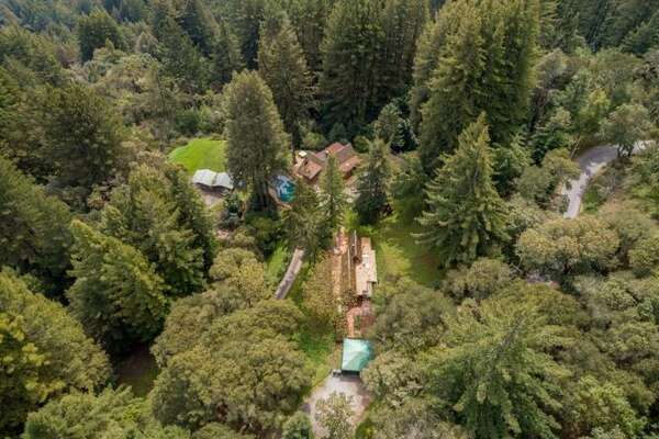 """A unique Woodside property offers three homes on one lot. The main house has two bedrooms and two bathrooms, an 1,100-square-foot guest home one bedroom and one bath and a 591-square-foot cottage another bedroom and bath. """"All of this is on approximately 2.65 acres with amazing views of the bay and the redwoods,"""" according to the listing."""