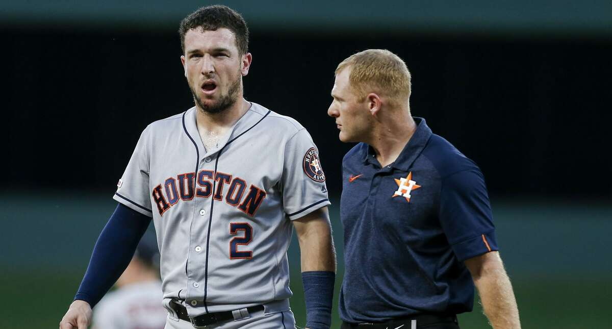 ARLINGTON, TX - JULY 11: Shortstop Alex Bregman #2 of the Houston Astros leaves the game after being hit the face by the ball during the third inning of a baseball game against the Texas Rangers at Globe Life Park July 11, 2019 in Arlington, Texas. Texas won 5-0. (Photo by Brandon Wade/Getty Images)