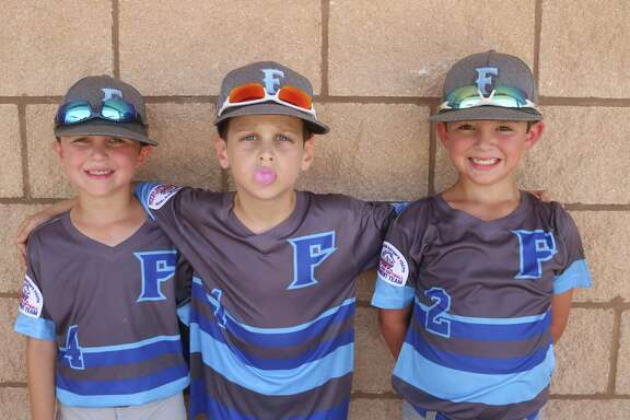 With the contributions of this Friendswood Blue trio, their bubble gum bubble hasn't popped so far at the 7U Pinto World Series. From left, Weston Snider, Jackson Becker and Callen Robinson have helped the team to a 2-0 start. They play Saturday morning at 9 for their final pool game.