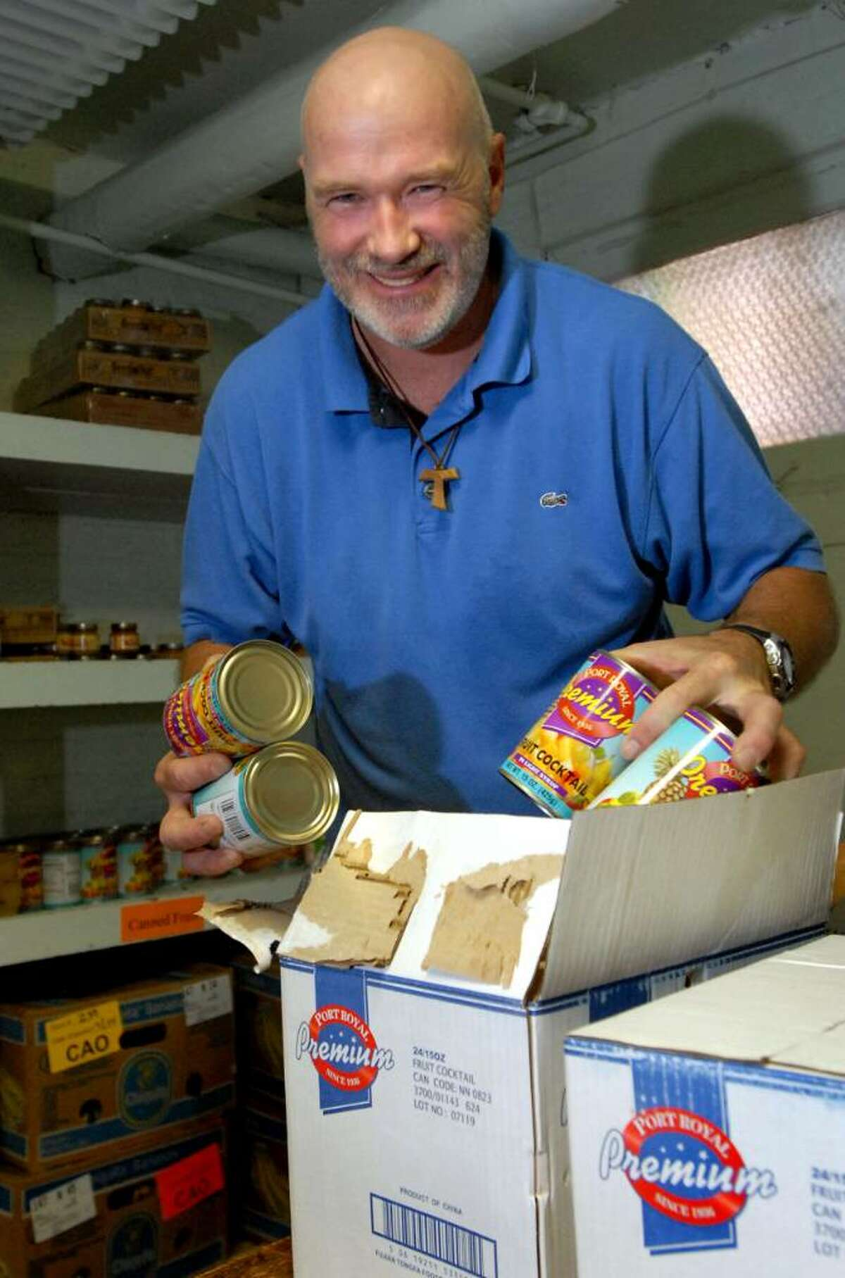 Friar Greg Spuhler, who has been reassigned by his Franciscan order to North Carolina, is concerned about feeding the hungry at a soup kitchen and food pantry as the Albany parish is closed.