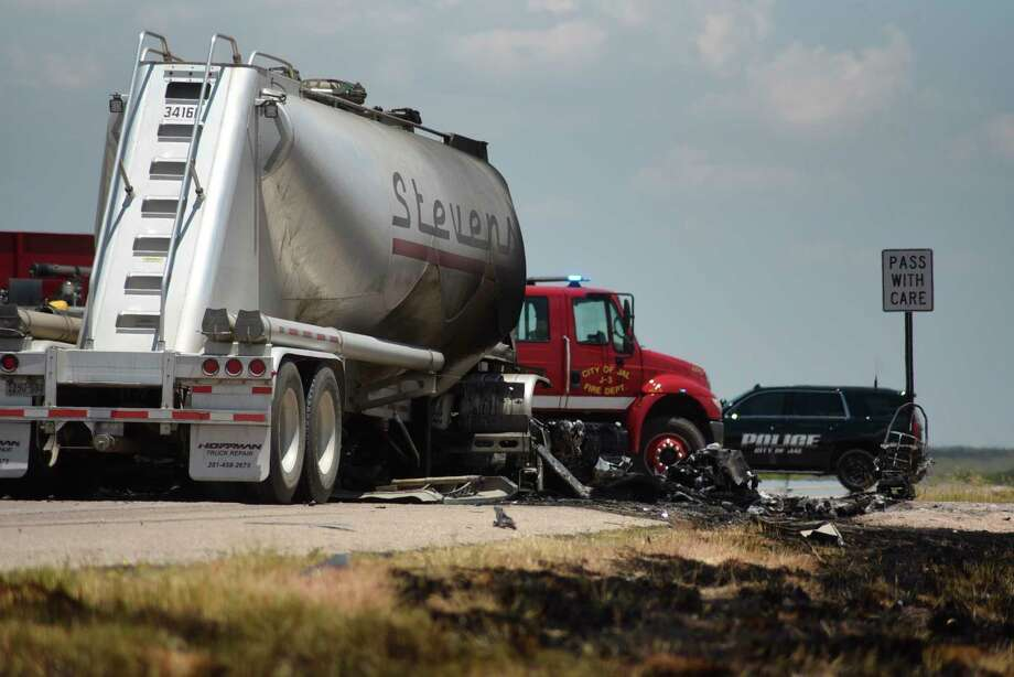 Grass along New Mexico State Route 128 near Jal shows burn marks following a fatal head-on crash Thursday, July 11, 2019. Authorities say four oilfield workers traveling in a pickup truck and the driver of a big rig were pronounced dead at the scene. (Jason Farmer/The Hobbs Daily News-Sun via AP) Photo: Jason Farmer, Associated Press / The Hobbs Daily News-Sun