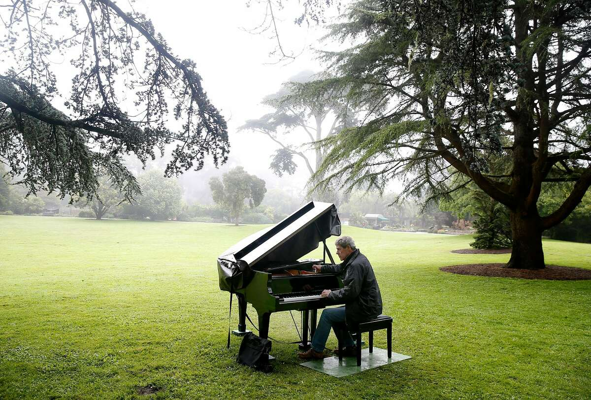 John McArdle tunes a baby grand in the Great Meadow for the 5th annual Flower Piano event at the S.F. Botanical Garden in San Francisco, Calif. on Friday, July 12, 2019. Twelve pianos are available throughout the garden at Golden Gate Park for the public to play and enjoy scheduled performances by professional musicians through July 22.