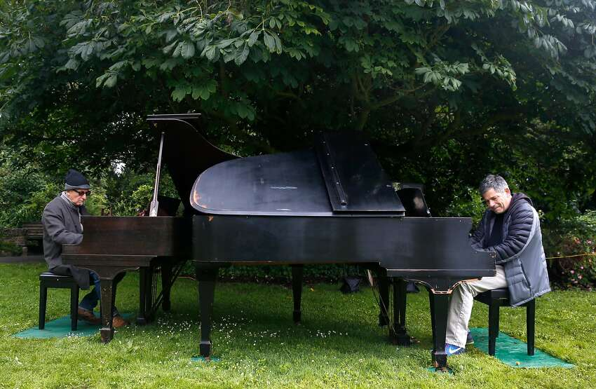 Dean Mermell (left) and Bobby Franz perform an impromptu duet at the Flower Piano event.