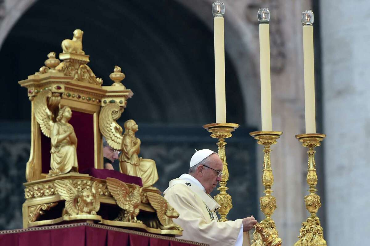Pope Francis leads a mass for the start of the Jubilee Year of Mercy, on December 8, 2015 at St Peter's square in Vatican. Pope Francis marks the start of an extraordinary Jubilee year for the world's 1.2 billion Catholics by opening a