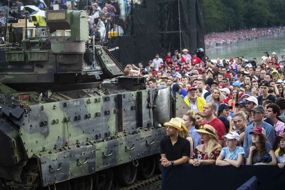 "Attendees stand next to an M2 Bradley infantry fighting vehicle during the Fourth of July ""Salute to America"" celebration in Washington. Photo: Al Drago /Bloomberg / © 2019 Bloomberg Finance LP"