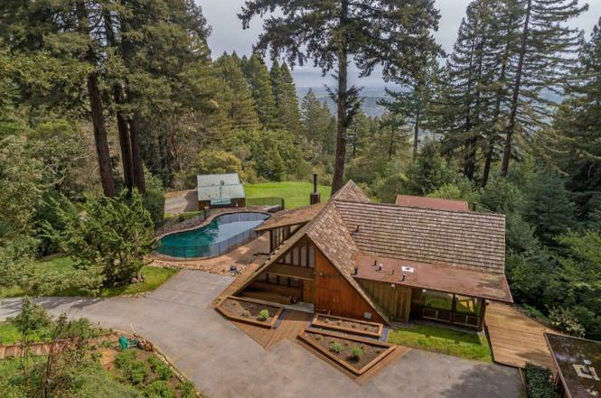"""A unique Woodside property offers three homes on one lot. The main house has two bedrooms and two bathrooms, an 1,100-square-foot guest home offers one bedroom and one bath and a 591-square-foot cottage withanother bedroom and bath. """"All of this is on approximately 2.65 acres with amazing views of the bay and the redwoods,"""" according to the listing."""