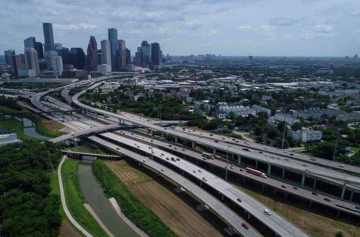 Interstate 45, left, and Interstate 10 diverge as they cross White Oak Bayou north of downtown Houston, seen on July 5, 2019.