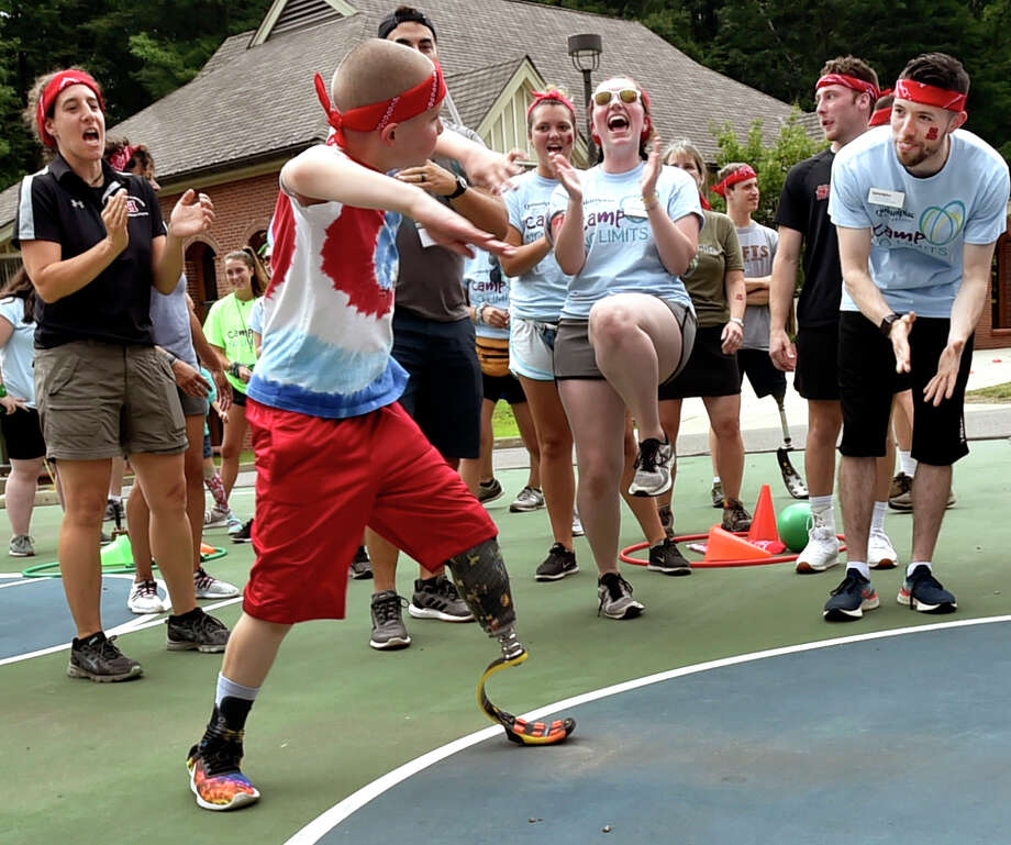"Hamden, Connecticut -Friday, July 12, 2019:  Ryan Werner, 9, of Syracuse, NY dances at Camp No Limits  hosted by Quinnipiac University's  occupational and physical therapy programs, an overnight camp for children and adolescents with limb loss and their families Friday during a ""Color Wars"" field day program competition at its York Hill Campus in Hamden. The camp runs through July 14. Camp No Limits purpose is to increase the functional independence of children living with limb loss. Approximately 22 campers and their families will participate in adaptive recreational activities,life skills programs and learn about the latest innovations in prosthetic options. These events will be led by physical and occupational therapists, prosthetists, Quinnipiac students and faculty, and teen and adult amputee mentors. Sports at the camp will include volleyball, sled hockey, basketball and bike clinics.  Quinnipiac University is the first and only institution of higher education in the country to host Camp No Limits. Camp No Limits was founded in 2004 by Mary Leighton, an occupational therapist from Maine. The camp began with four children. Today, there are ten locations nationwide, serving hundreds of families. In addition to Connecticut, Camp No Limits is offered in California, Florida, Idaho, Maine, Maryland, Missouri and Texas. Photo: Peter Hvizdak, Hearst Connecticut Media / New Haven Register"