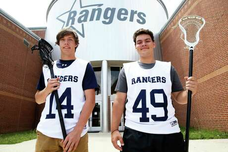 Will Ford, left, and Conner Cuellar stand with their lacrosse equipment at Smithson Valley High School on July 12, 2019.