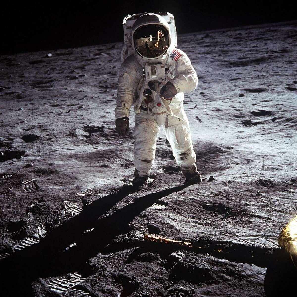 Buzz Aldrin walks on the moon.
