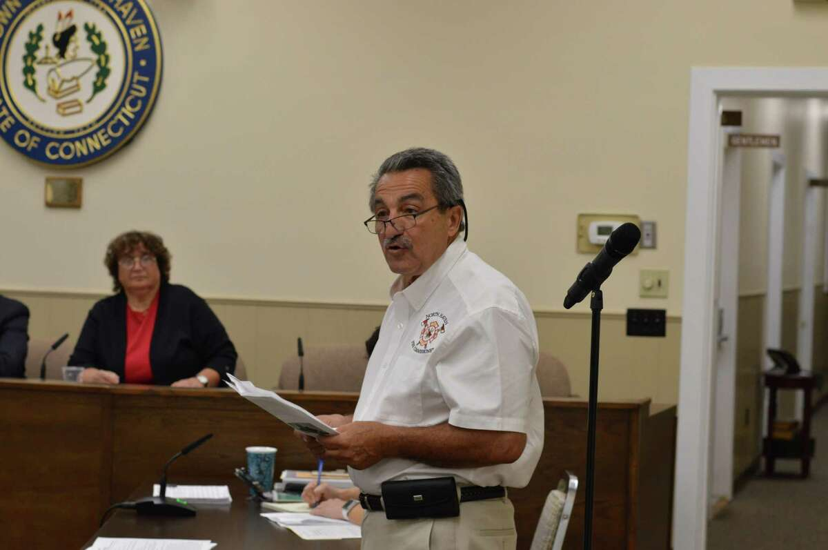 North Haven Fire Commission Chairman Peter Criscuolo presented a $12,500 check from the Town Fair Tire Foundation to the Fire Department to buy 10 ballistic vests and helmets Thursday, July 11, 2019.