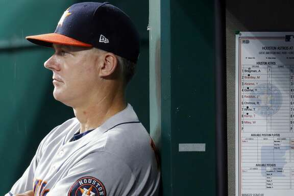 Houston Astros manager AJ Hinch looks on from the dugout in the fifth inning of a baseball game against the Cincinnati Reds, Monday, June 17, 2019, in Cincinnati. (AP Photo/John Minchillo)