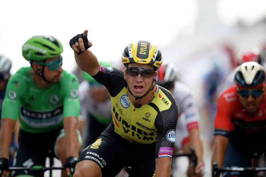 Netherlands' Dylan Groenewegen celebrates as he crosses the finish line to win the seventh stage of the Tour de France cycling race over 230 kilometers (142,9 miles) with start in Belfort and finish in Chalon sur Saone, France, Friday, July 12, 2019. (AP Photo/Christophe Ena) Photo: Christophe Ena / Copyright 2019 The Associated Press. All rights reserved