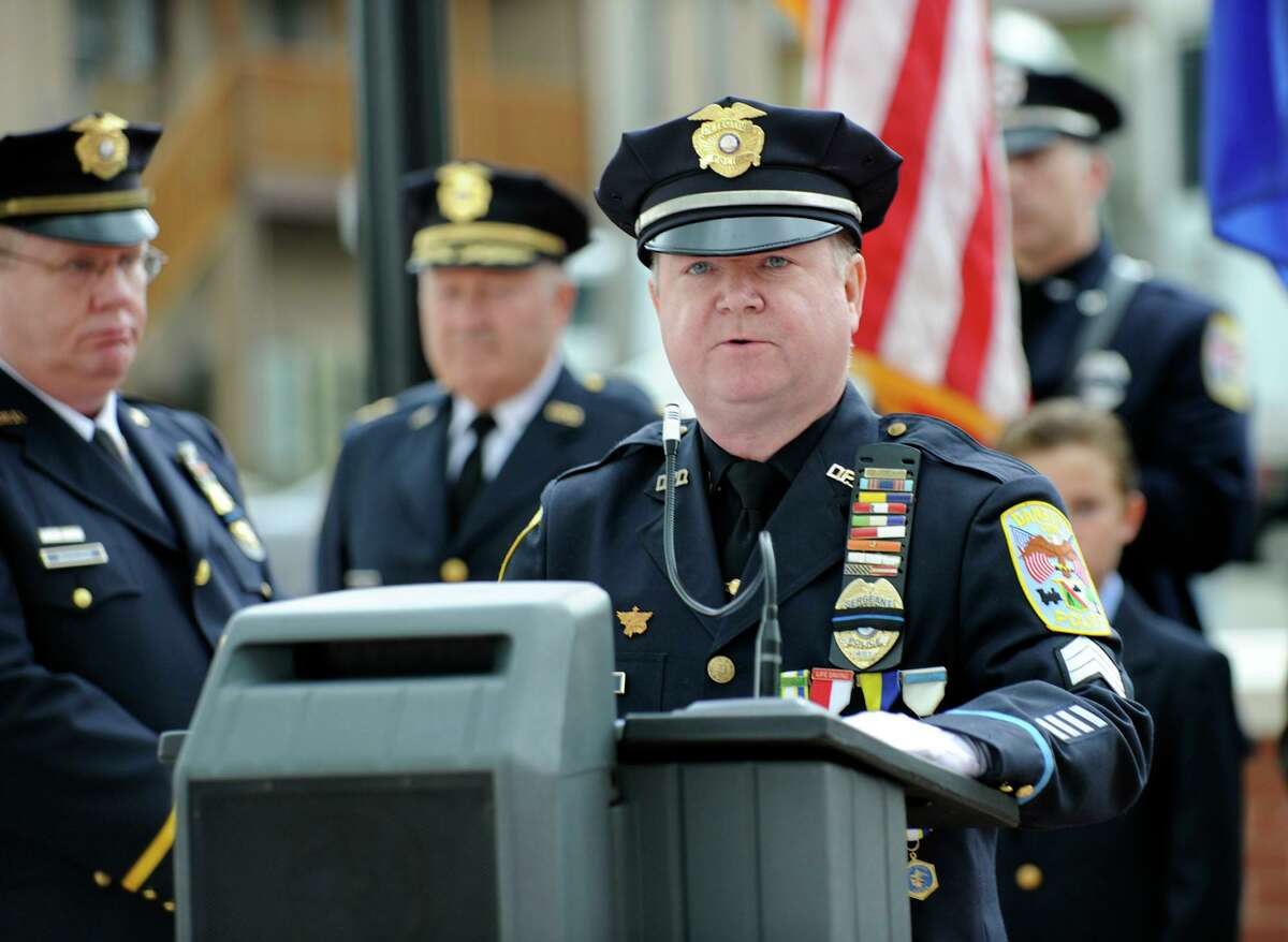 Sgt. John Krupinsky gives the national memorial service reading at the Danbury Police Department memorial service on May 23, 2012.