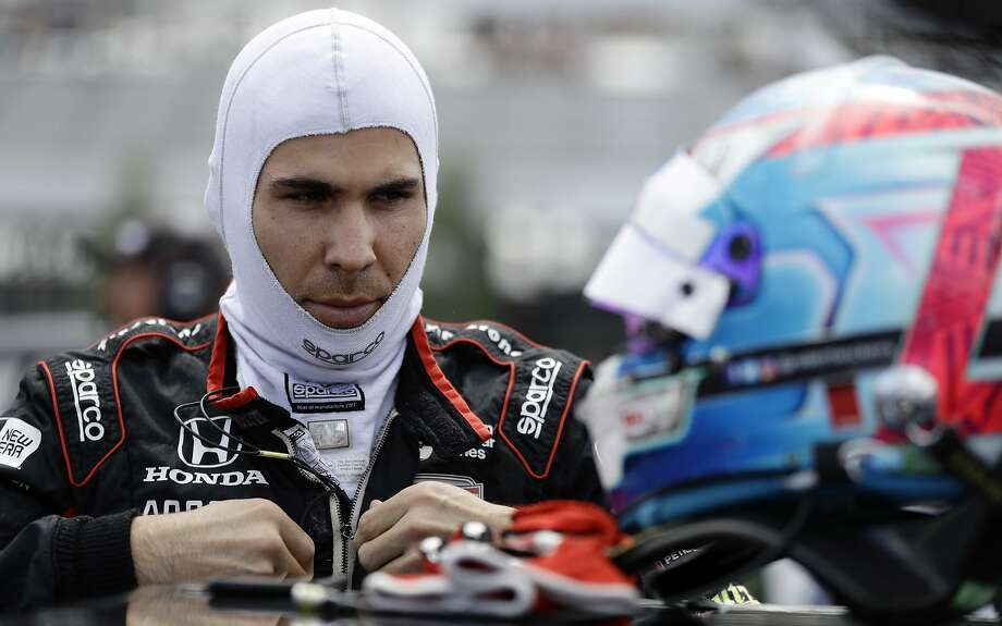 FILE - In this Aug. 18, 2018, file photo, Robert Wickens prepares to qualify for an IndyCar series auto race in Long Pond, Pa. Nearly a year after his devastating injury in an IndyCar race, Wickens will indeed get to drive a car again at a race track. He will lead the parade lap Sunday before the Toronto IndyCar race in an Acura NSX equipped with hand controls.. (AP Photo/Matt Slocum, File) Photo: Matt Slocum, Associated Press