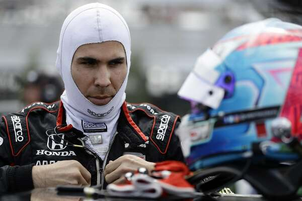 FILE - In this Aug. 18, 2018, file photo, Robert Wickens prepares to qualify for an IndyCar series auto race in Long Pond, Pa. Nearly a year after his devastating injury in an IndyCar race, Wickens will indeed get to drive a car again at a race track. He will lead the parade lap Sunday before the Toronto IndyCar race in an Acura NSX equipped with hand controls.. (AP Photo/Matt Slocum, File)