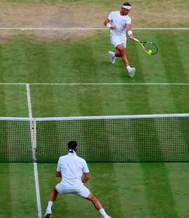 Eleven years after playing one of the greatest matches in history, Spain's Rafael Nadal (top) and Switzerland's Roger Federer went at it again Friday on Centre Court at Wimbledon.