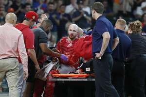 Los Angeles Angels catcher Jonathan Lucroy (20) is put on a cart to after Houston Astros Jake Marisnick (6) collided with him at home during the eighth inning of an MLB game at Minute Maid Park, Sunday, July 7, 2019, in Houston.