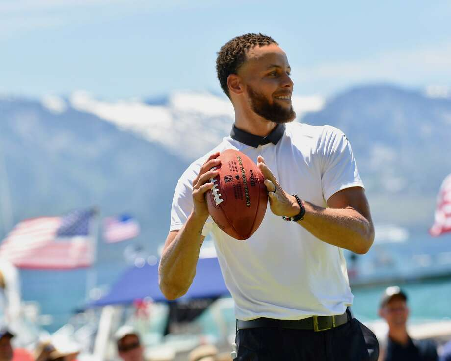 Stephen Curry tosses a football during Friday play at the American Century Championship golf tournament at Edgewood Tahoe Golf Course in Stateline, Nevada. Photo: Jeff Bayer/American Century Championship