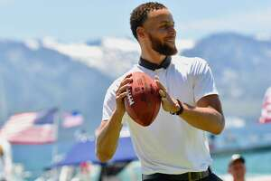 Stephen Curry tosses a football during Friday play at the American Century Championship golf tournament at Edgewood Tahoe Golf Course in Stateline, Nevada.