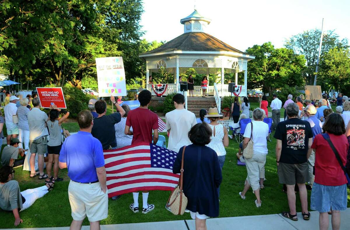 A Lights for Liberty vigil is held on Sherman Green in Fairfield, Conn., on Friday July 12, 2019. This is one of as many as 700 Lights for Liberty events happening nationwide as a movement to end the human detention camps for immigrants seeking asylum.