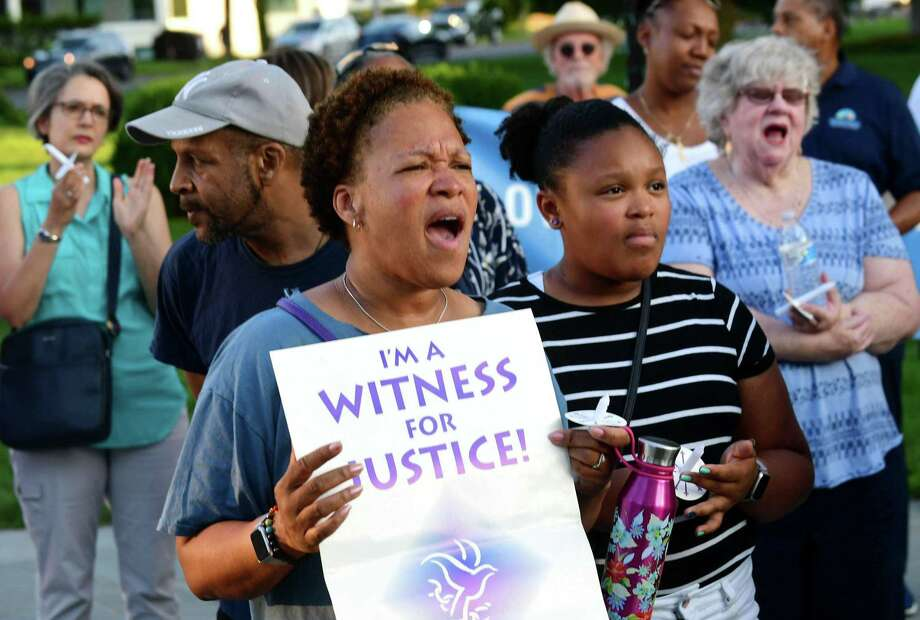 Norwalk resident Erika Foster and her daughter, Ciara Walker, 12, attend The Norwalk DTC vigil on the Norwalk Green in protest of the Trump administration's border policies Friday. The Vigil was held in conjunction with similar demonstrations around Fairfield County. Photo: Erik Trautmann / Hearst Connecticut Media / Norwalk Hour